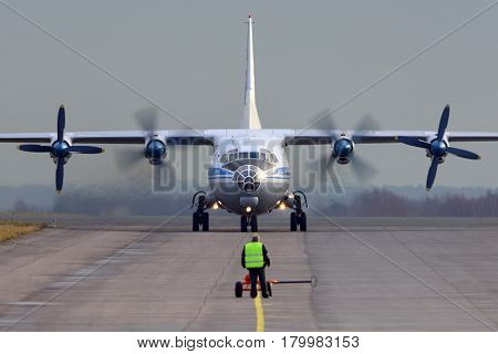 ZHUKOVSKY, MOSCOW REGION, RUSSIA - OCTOBER 19, 2013: Antonov An-12 taxiing at Zhukovsky.