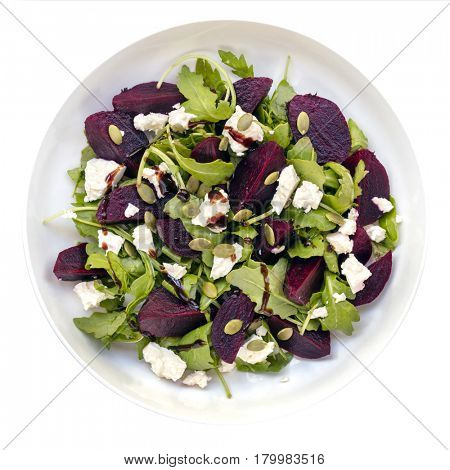 Beetroot salad, isolated, top view.  Includes feta cheese, arugula, and pumpkin seeds.