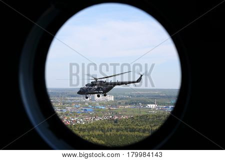 MOSCOW REGION, RUSSIA - MAY 9, 2015: Mil Mi-8AMTSH helicopter of Russian Air Force seen from window during Victory Day parade.