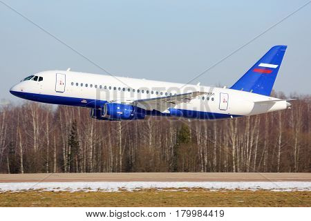 ZHUKOVSKY, MOSCOW REGION, RUSSIA - MARCH 2, 2014: Sukhoi Superjet-100 RF-89151 performing low pass in Zhukovsky.