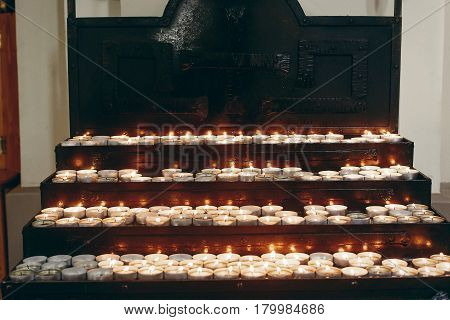 Group Of Burning Candles On Church Altar Close-up In Christian Catholic Church, Flaming Candles, Fun