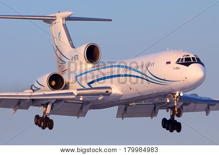 VNUKOVO, MOSCOW REGION, RUSSIA - MARCH 23, 2013: Tupolev Tu-154M old russian commercial airliner of Gazpromavia airlines landing at Vnukovo international airport at the day end.