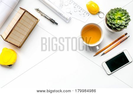 architect office with tools, cup and phone in profession concept on white desk background top view mock up
