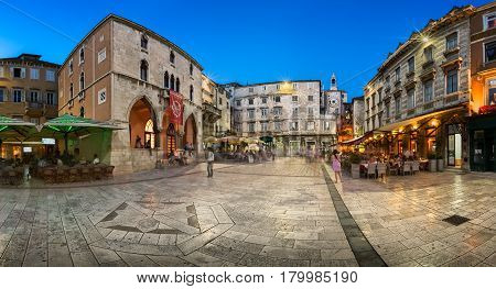 SPLIT CROATIA - JUNE 28 2014: Panorama of Narodni Trg and Iron Gate of Deoclitian Palace in Split. Palace was built by emperor Diocletian in preparation for his retirement on 1 May 305 AD.