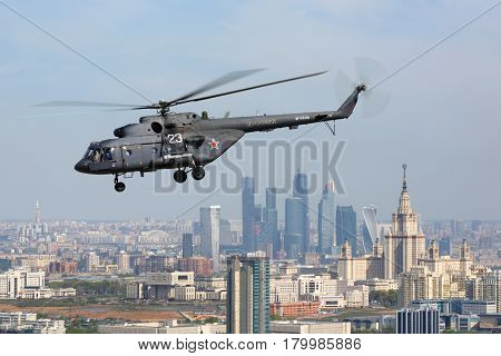 MOSCOW RUSSIA - MAY 9, 2015: Mil Mi-8AMTSH helicopter of Russian Air Force during Victory Day parade flying over Moscow city.
