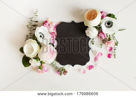 Floral round wedding frame flat lay. Rose flowers top view with copy space