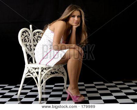 Girl On Wicker Chair