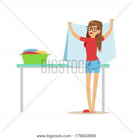 Woman Folding Clean Laundry, Part Of People Using Automatic Self-Service Laundromat Washing Machines Of Vector Illustrations. Person Taking Care Of The Clothes And Laundry Cartoon Drawing With Smiling Character.