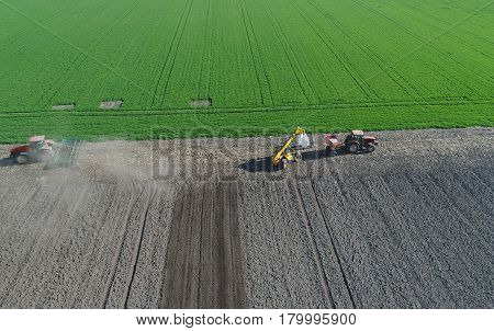 Agricultural Work On Field In Spring