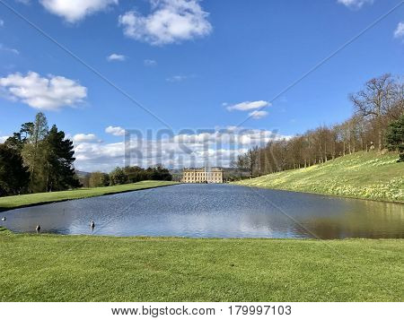 CHATSWORTH HOUSE - MARCH 31, 2017: Canal Pond at Chatsworth House in the Derbyshire Dales area of the Peak District, Derbyshire, UK.