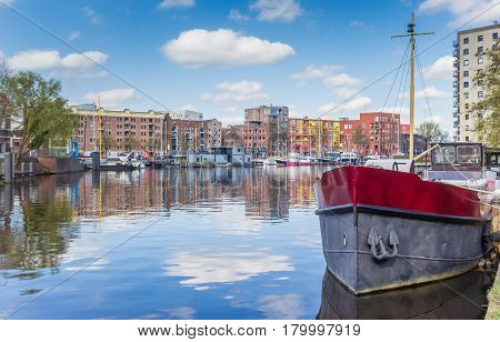 Old ship and colorful apartments in the east harbor of Groningen Holland