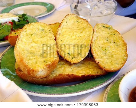 Snacks. Baked bread with garlic parsley and cheese