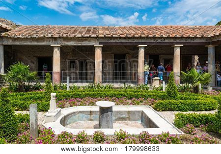 POMPEII, ITALY - MAY 13, 2014: A beautiful ancient house. Pompeii is an ancient Roman city died from the eruption of Mount Vesuvius in 79 AD.