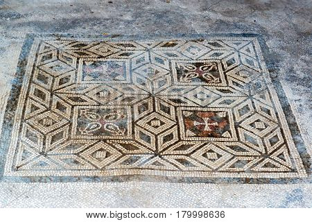 Floor mosaic in Pompeii, Italy. Pompeii is an ancient Roman city died from the eruption of Mount Vesuvius in 79 AD.