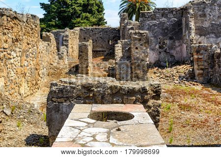 Stove of an ancient bar (thermopolium) in Pompeii, Italy. Pompeii is an ancient Roman city died from the eruption of Mount Vesuvius in 79 AD.