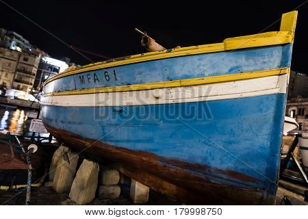 Boat On The Shore Of Spinola Bay, Malta