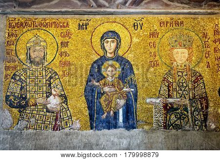 ISTANBUL - MAY 25, 2013: Ancient mosaic in Hagia Sophia: Virgin Mary with Christ and the imperial family. Hagia Sophia is the greatest monument of Byzantine Culture. It was built in the 6th century.