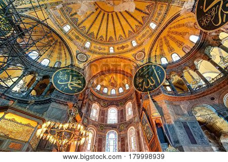 ISTANBUL - MAY 25, 2013: Inside the Hagia Sophia in Istanbul. Hagia Sophia is the greatest monument of Byzantine Culture.