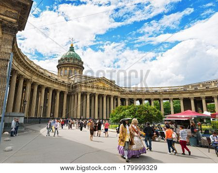ST PETERSBURG, RUSSIA - JUNE 14, 2014: Tourists visiting the Kazan Cathedral. The cathedral is one of the main attractions of the city.