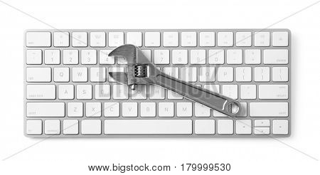 Modern wireless keyboard and adjustable wrench on white background