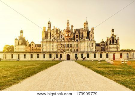 The royal Chateau de Chambord at sunset, France. This castle is located in the Loire Valley was built in the 16th century and is one of the most recognizable chateaux in the world.
