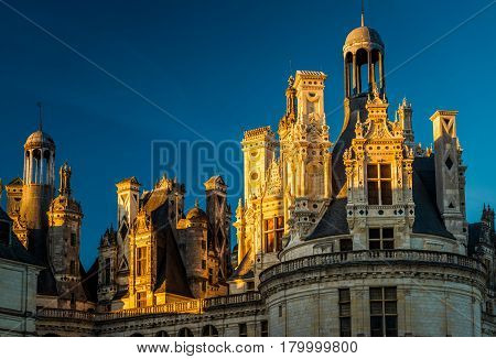 The royal Chateau de Chambord at sunset, France. This famous castle is located in the Loire Valley, was built in the 16th century and is one of the most recognizable chateaux in the world.