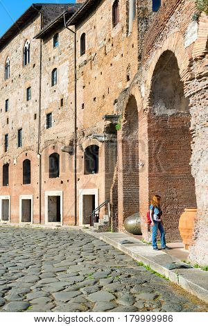 Young female tourist visits the Market of Trajan in Rome, Italy