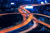 Motorway Expressway Freeway the infrastructure for transportation in modern city urban view at night time poster