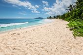 Sunny day on Anse Nord D'Est beach in the north of Mahe Island Seychelles poster