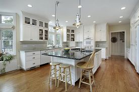 Kitchen in luxury home with large granite island.