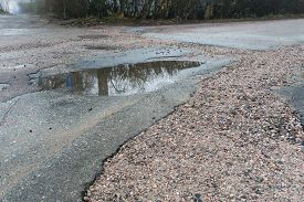 Pot Holes With Water In Road