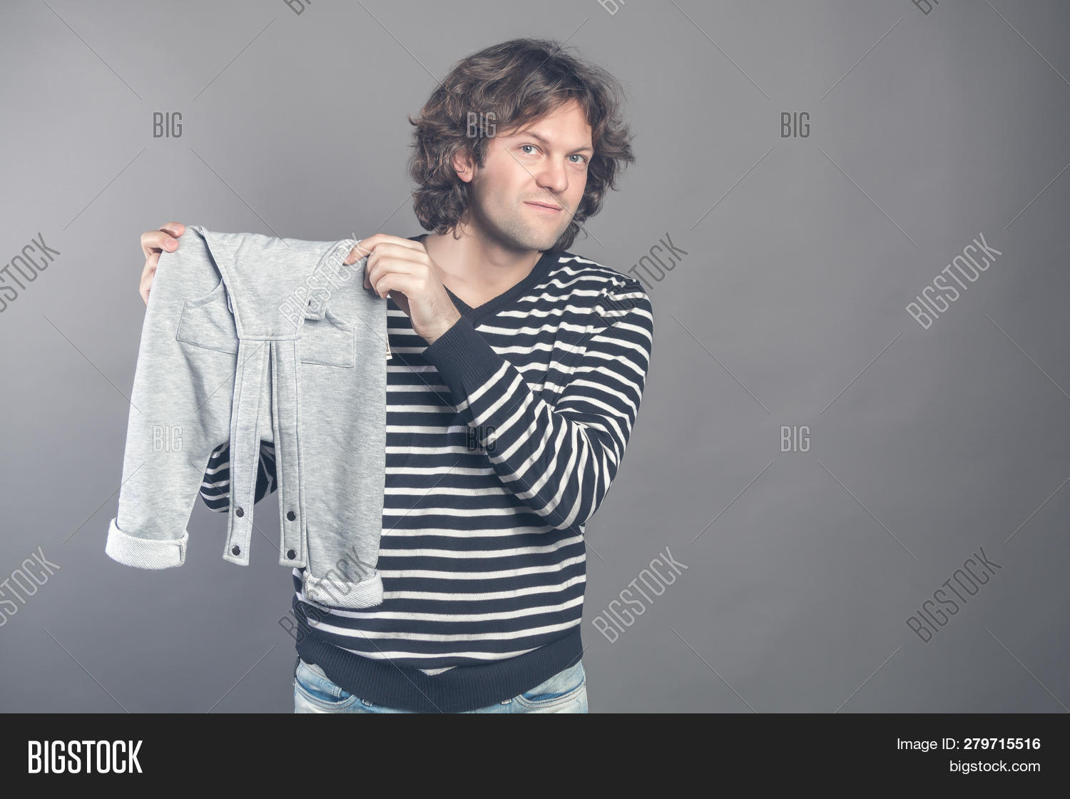 4a696c0d4 Young Caucasian Male Boasting About New Stylish Baby Clothes For His Son  Holding In Hands And