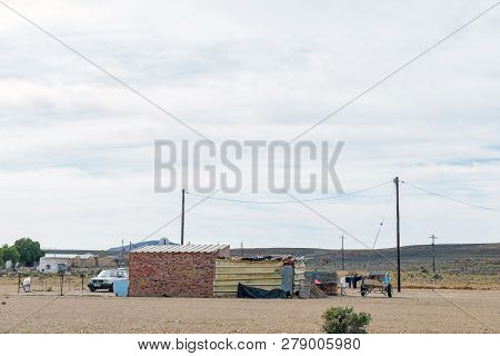 Middelpos, South Africa, August 31, 2018: A House In Middelpos In The Northern Cape Karoo. A Car And