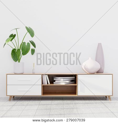 Modern Living Room Interior With A Wooden Dresser And A Green Plant, Wall Mockup, 3d Render
