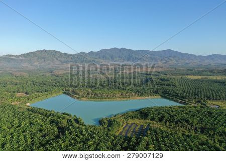 Aerial photo countryside in thauiland. Lake, rubber and palm oil plantations