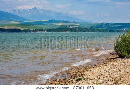 Liptovska Mara Lake Reservoir And High Tatras Behind Spring View, Slovakia