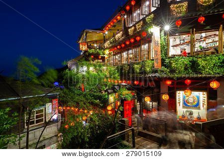 Jiufen, Taiwan - November 7, 2018: A Night View Of The Famous Old Teahouse Decorated With Chinese La