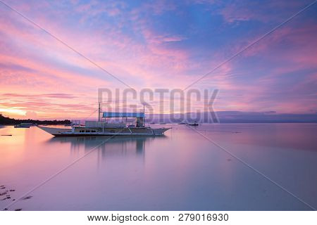 Sunset View Of The Dolho Beach With Traditional Bangka Boat, Panglao, Bohol, Philippines