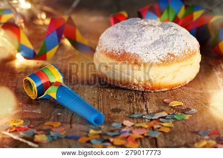 Colorful Carnival Celebration With Sweet Donut On Rustic Wood