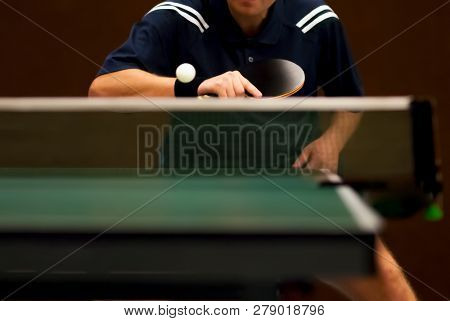table tennis player returning, focus at the blade