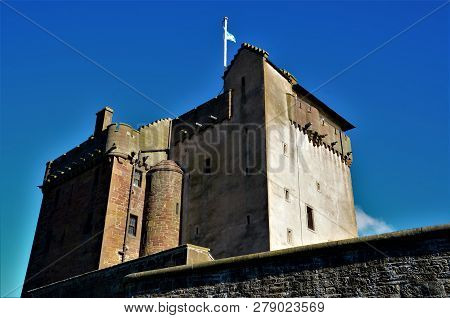 An exterior view of a history medieval castle turret building in the town of Broughty ferry in Scotland poster