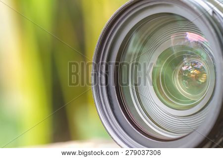 Camera Lens With Lense Reflections Modern Ultra Zoom Photo Camera Front View,black Dslr Camera,blurr