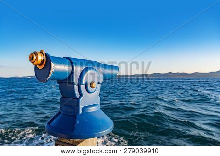 Binoculars For Tourists On The Beach In The Evening.