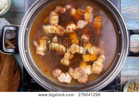 Chef Putting Water For Cooking Streaky Pork In Pot / Cooking Sweet Brown Stewed Pork Gravy (moo Pa-l
