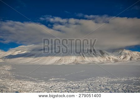 Mountain With Snow Against The Blue Sky In Umbria