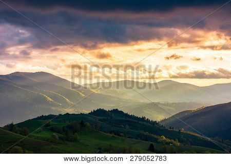 Wonderful Countryside In Springtime At Sunset. Gorgeous Cloudscape Above The The Rolling Hills In Ru