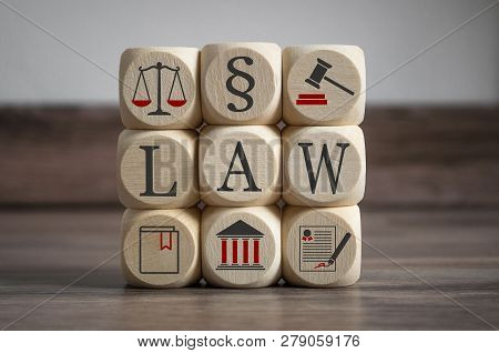 Cubes And Dices With Law Symbols On Wooden Background