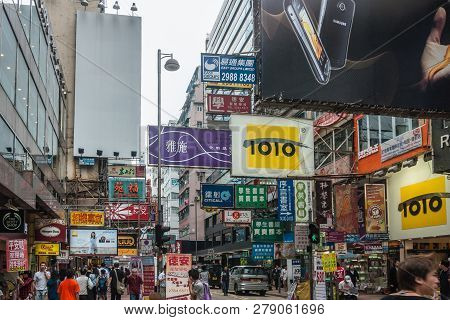 Hong Kong, China  - May 13, 2010: Kowloon Mainland Section. Colorful Commercial Sign, Print And Ligh