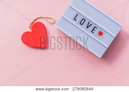 Love Is A Word Is Written On Light Box. Love Inscription. Decoration For Wedding Party Or Valentines
