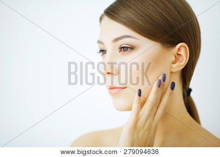 Beauty Youth Skin Care Concept - Close Up Beautiful Caucasian Woman Face Portrait Applying Some Crea